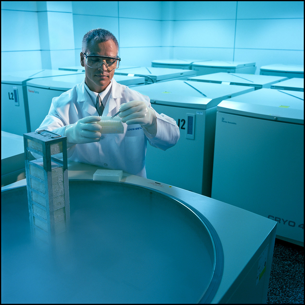 A researcher accesses frozen DNA samples in a room full of cryogenic vaults.