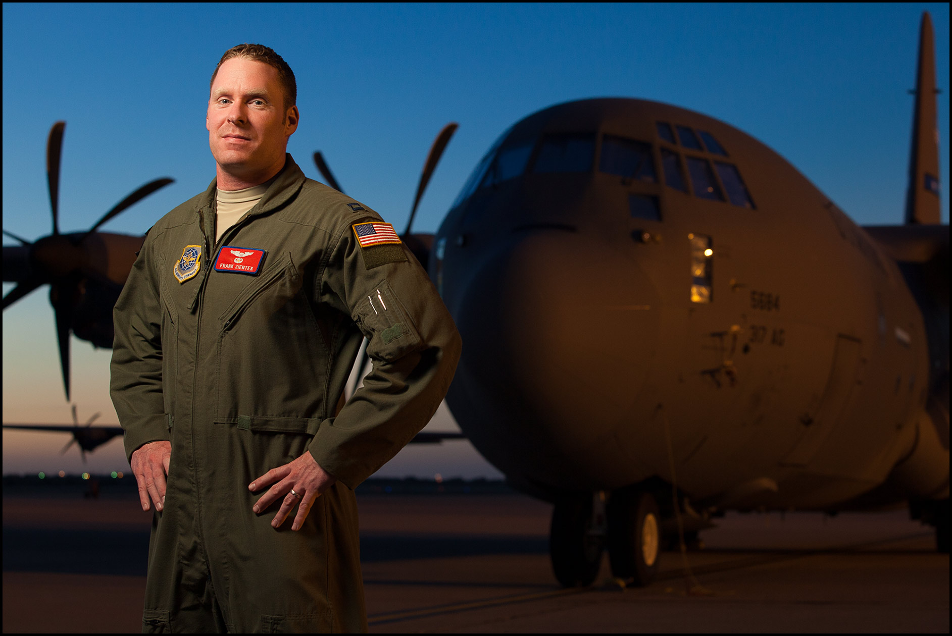 A portrait of a USAF Captain in front of a C-130 J transport aircraft at Dyess AFB.